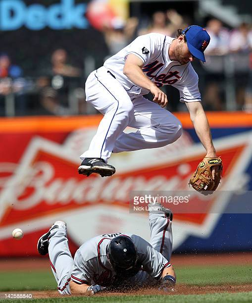 Matt Diaz of the Atlanta Braves breaks up a double play under Daniel Murphy of the New York Mets at Citi Field on April 8, 2012 in New York City.