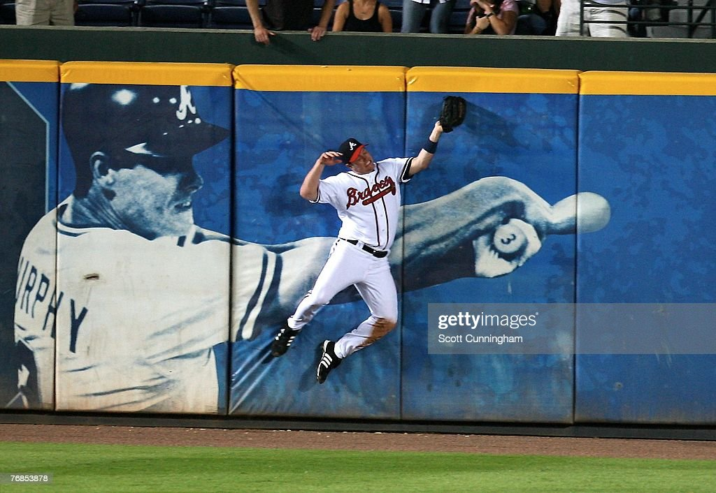 Matt Diaz #23 of the Atlanta Braves makes a catch against the wall during the game against the Florida Marlins at Turner Field on September 18, 2007 in Atlanta, Georgia. The Braves defeated the Marlins 4-3.