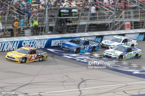Matt DiBenedetto driver of the CanAm/Kappa Ford David Ragan driver of the Overton's Ford Ty Dillon driver of the GEICO Chevrolet and Corey LaJoie...