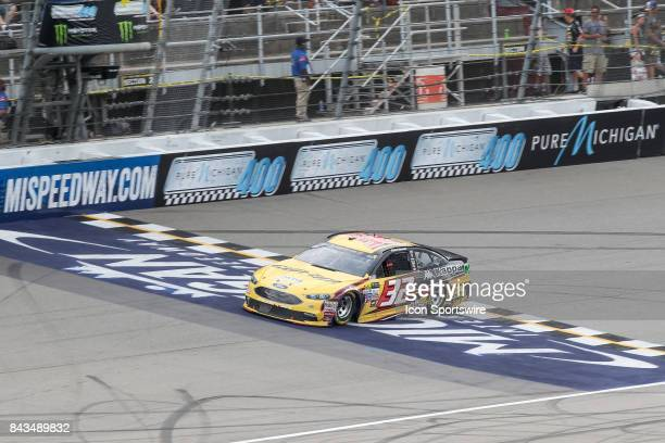 Matt DiBenedetto driver of the CanAm/Kappa Ford races during the Monster Energy NASCAR Cup Series Pure Michigan 400 race on August 13 2017 at...