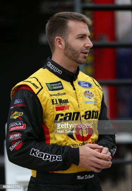 Matt DiBenedetto driver of the CanAm/Kappa Ford stands in the garage area during practice for the Monster Energy NASCAR Cup Series AAA Texas 500 at...