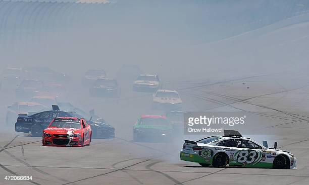 Matt DiBenedetto driver of the Dustless Blasting Toyota Justin Allgaier driver of the Brandt Chevrolet and Ricky Stenhouse Jr driver of the Fifth...