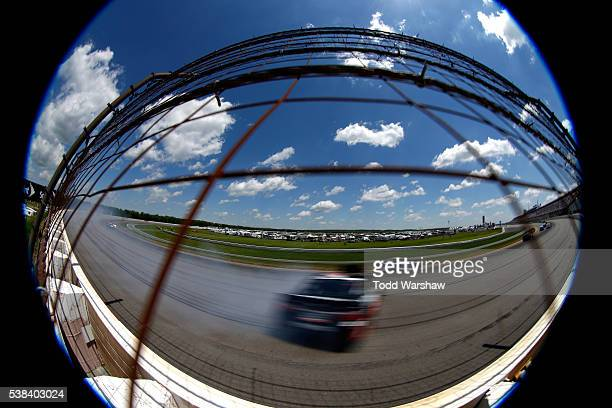 Matt DiBenedetto driver of the EJ Wade Construction Toyota spins during the NASCAR Sprint Cup Series Axalta 'We Paint Winners' 400 at Pocono Raceway...