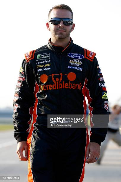 Matt DiBenedetto driver of the Incredible Bank/Ninja Turtles Samurai Ford stands on the grid during qualifying for the NASCAR Camping World Truck...