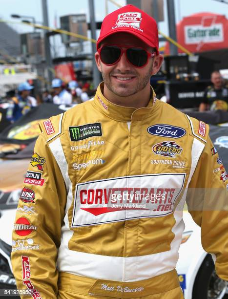 Matt DiBenedetto driver of the Keen Parts/Corvettepartsnet Ford walks on the grid during qualifying for the Monster Energy NASCAR Cup Series...