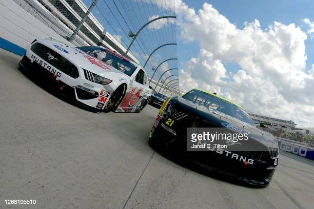 Matt DiBenedetto, driver of the Menards/Monster Energy Ford, and Ryan Newman, driver of the Guaranteed Rate Ford, lead the field on a pace lap prior...