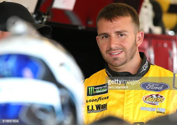 Matt DiBenedetto driver of the The Hurricane Heist Ford stands in the garage during practice for the Monster Energy NASCAR Cup Series Daytona 500 at...