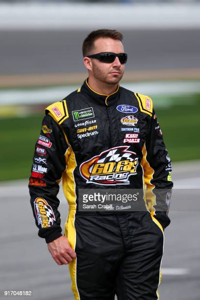 Matt DiBenedetto driver of the The Hurricane Heist Ford walks the grid during qualifying for the Monster Energy NASCAR Cup Series Daytona 500 at...