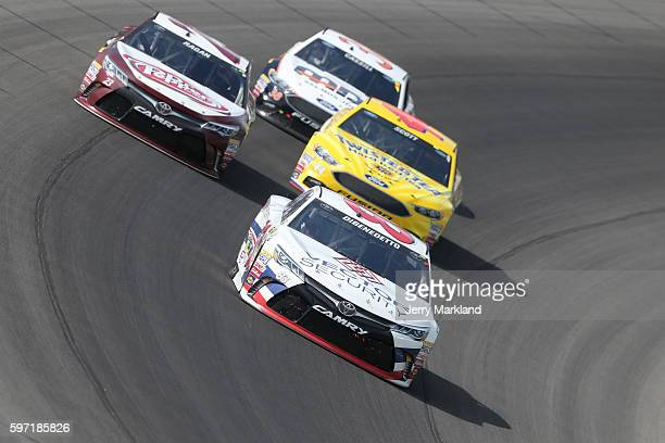 Matt DiBenedetto driver of the Vector Security Toyota leads a pack of cars during the NASCAR Sprint Cup Series Pure Michigan 400 at Michigan...
