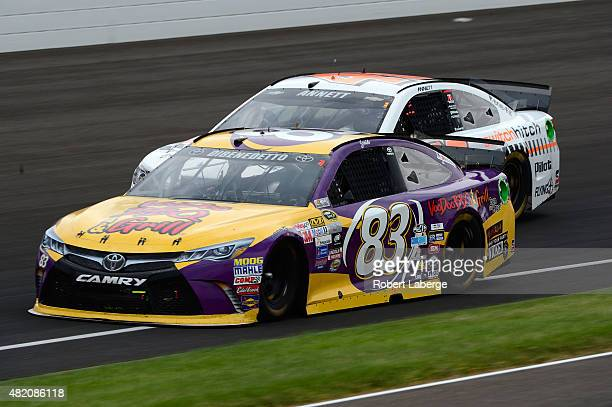 Matt DiBenedetto driver of the VooDoo BBQ Grill Toyota and Michael Annett driver of the Switch Hitch Chevrolet race during the NASCAR Sprint Cup...
