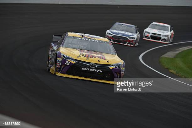Matt DiBenedetto driver of the VooDoo BBQ Grill Toyota races during the NASCAR Sprint Cup Series Crown Royal Presents the Jeff Kyle 400 at the...