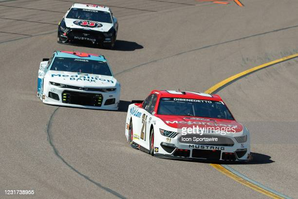 Matt DiBenedetto, driver of the Wood Brothers Racing Motorcraft/Quick Lane Ford Mustang, races in front of Erik Jones, driver of the Richard Petty...