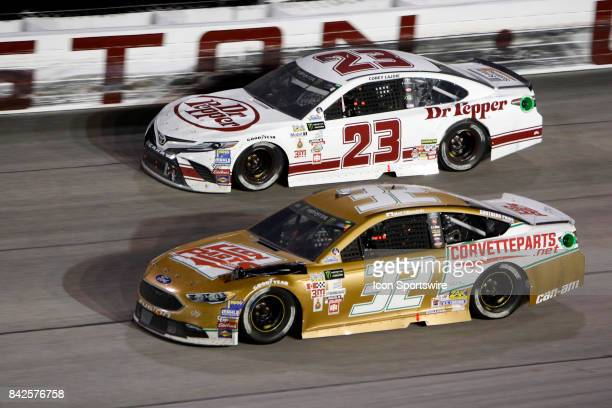 Matt DiBenedetto GO FAS Racing Keen Parts Ford Fusion and Joey Gase BK Racing Dr Pepper Toyota Camry during the Bojangles Southern 500 on September 3...