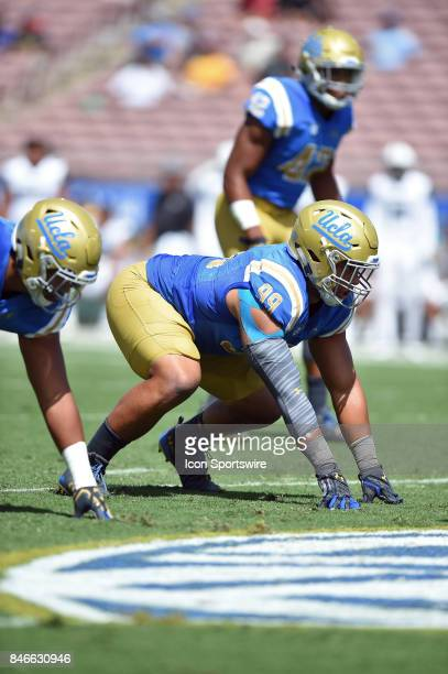 Matt Dickerson lines up in his stance during a college football game between the Hawai'i Rainbow Warriors and the UCLA Bruins on September 09 2017 at...