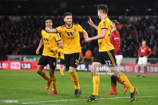Matt Doherty and Leander Dendoncker of Wolverhampton Wanderers celebrate after their team's second goal during the Premier League match between...
