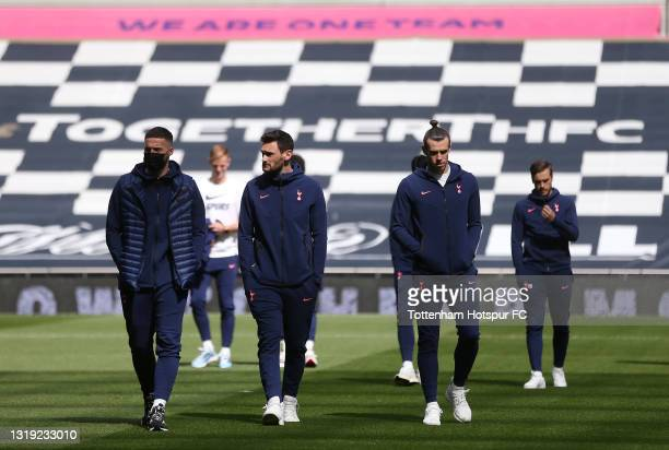 Matt Doherty, Hugo Lloris and Gareth Bale of Tottenham Hotspur walk on the pitch prior to the Premier League match between Tottenham Hotspur and...