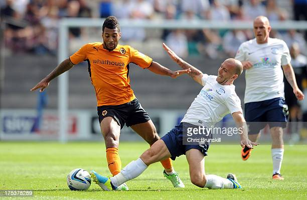 Matt Doherty of Preston North End tackles Nicky Wroe of Wolverhampton Wanderers during the Sky Bet League One match between Preston North End and...