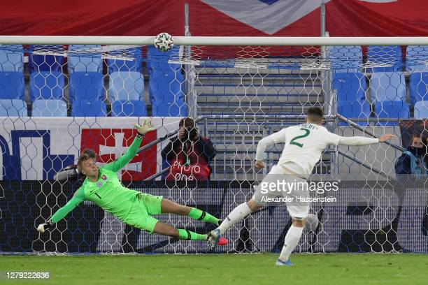 Matt Doherty of Republic of Ireland hits the bar from the penalty spot as Marek Rodak of Slovakia dives to make a save during the penalty shoot out...