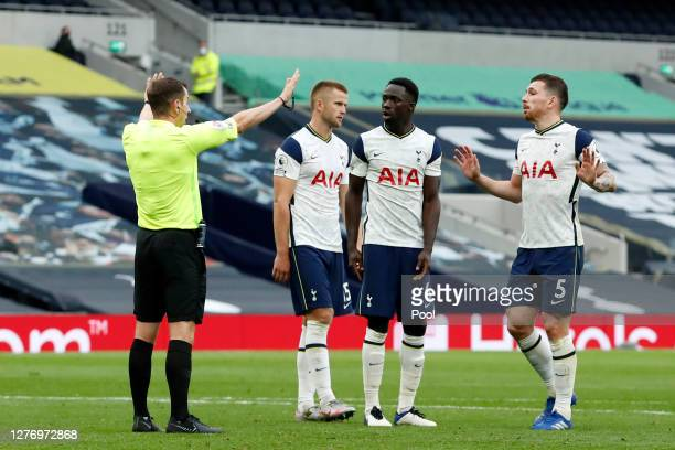 Matt Doherty of Tottenham Hotspur confronts referee Peter Bankes during the Premier League match between Tottenham Hotspur and Newcastle United at...
