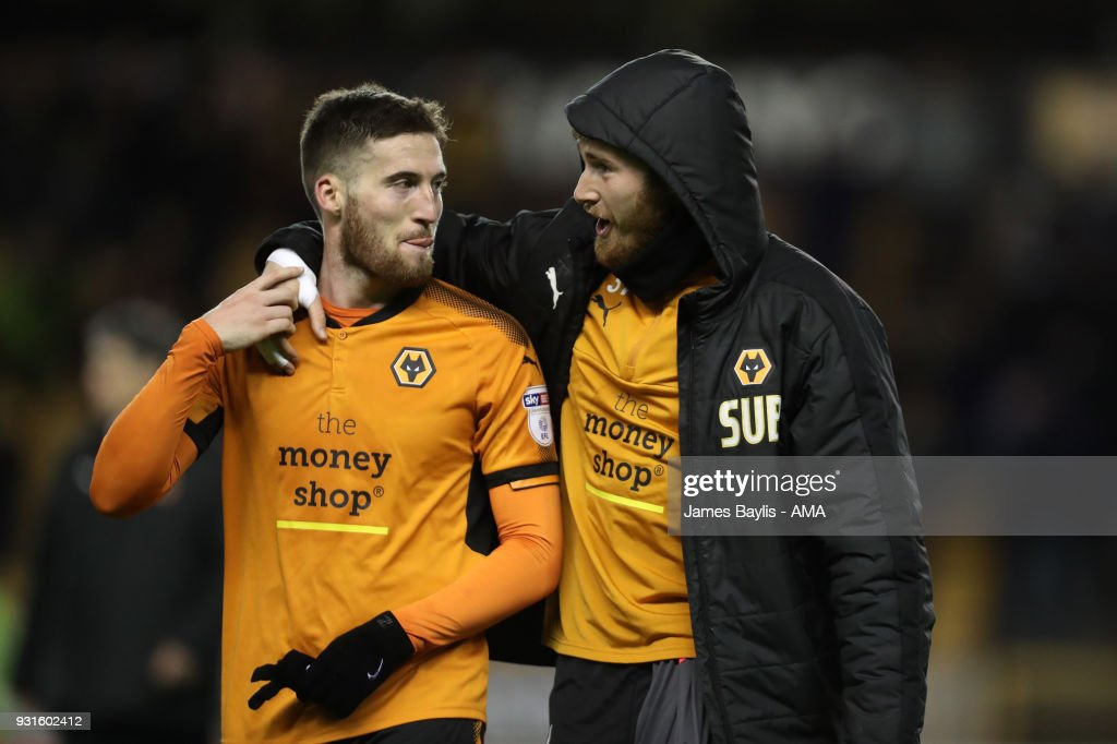 Matt Doherty of Wolverhampton Wanderers and Will Norris of Wolverhampton Wanderers celebrate at full time during the Sky Bet Championship match between Wolverhampton Wanderers and Reading at Molineux on March 3, 2018 in Wolverhampton, England.