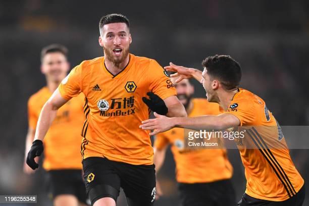Matt Doherty of Wolverhampton Wanderers celebrates after scoring his sides third goal during the Premier League match between Wolverhampton Wanderers...
