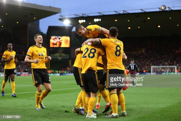 Matt Doherty of Wolverhampton Wanderers celebrates with team mates after scoring a goal to make it 20 during the Premier League match between...