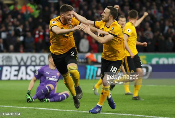 Matt Doherty of Wolverhampton Wanderers celebrates with teammate Diogo Jota after scoring his team's second goal during the Premier League match...