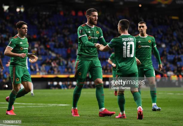 Matt Doherty of Wolverhampton Wanderers celebrates with teammates Daniel Podence and Ruben Neves of Wolverhampton Wanderers after scoring his teams...