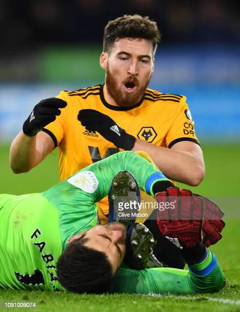Matt Doherty of Wolverhampton Wanderers collides with Lukasz Fabianski of West Ham United during the Premier League match between Wolverhampton...