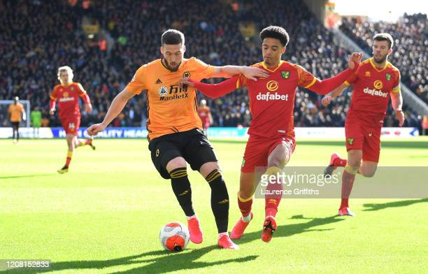 Matt Doherty of Wolverhampton Wanderers holds off Jamal Lewis of Norwich City during the Premier League match between Wolverhampton Wanderers and...
