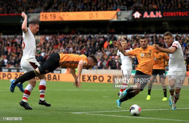 Matt Doherty of Wolverhampton Wanderers is tackled by PierreEmile Hojbjerg of Southampton leading to a penalty decision for Wolverhampton Wanderers...