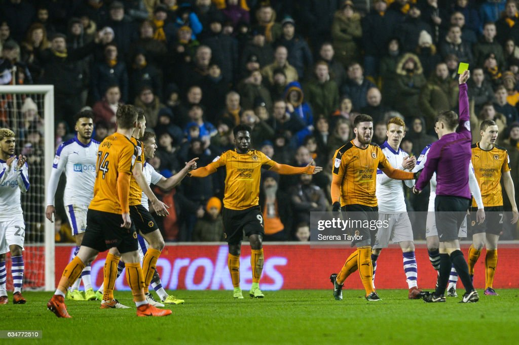 Matt Doherty of Wolverhampton Wanderers (2) receives a yellow card by Referee Craig Pawson during the Sky Bet Championship match between Wolverhampton Wanderers and Newcastle United at Molineux on February 11, 2017 in North Shields, England.