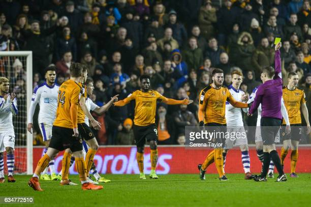 Matt Doherty of Wolverhampton Wanderers receives a yellow card by Referee Craig Pawson during the Sky Bet Championship match between Wolverhampton...