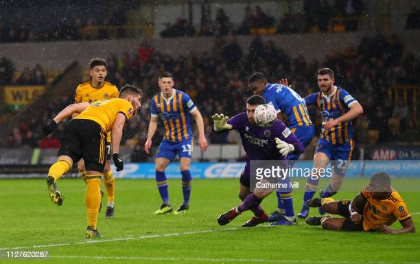 Matt Doherty of Wolverhampton Wanderers scores his side's second goal past Steve Arnold of Shrewsbury Town during the FA Cup Fourth Round Replay...