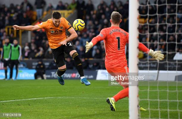 Matt Doherty of Wolverhampton Wanderers scores his team's first goal and equaliser during the Premier League match between Wolverhampton Wanderers...