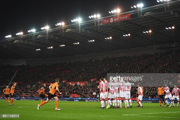 Matt Doherty of Wolverhampton Wanderers scores his team's second goal from a free kick during The Emirates FA Cup Third Round match between Stoke...