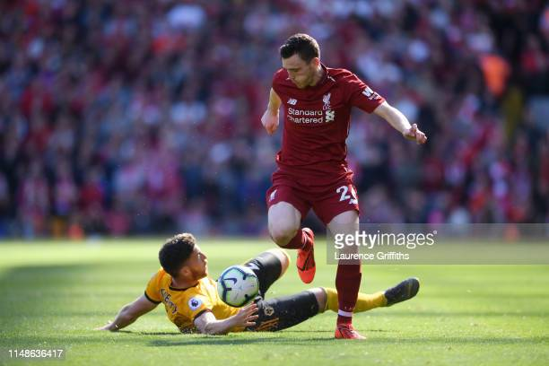 Matt Doherty of Wolverhampton Wanderers tackles Andy Robertson of Liverpool during the Premier League match between Liverpool FC and Wolverhampton...