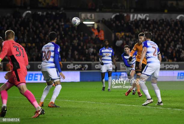 Matt Doherty of Wolverhampton Wanders heads in the opening goal during the Sky Bet Championship match between Wolverhampton Wanderers and Reading at...
