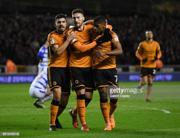 Matt Doherty of Wolverhampton Wanders is congratulated on scoring the opening goal by Ruben Neves and Ivan Cavaleiro during the Sky Bet Championship...