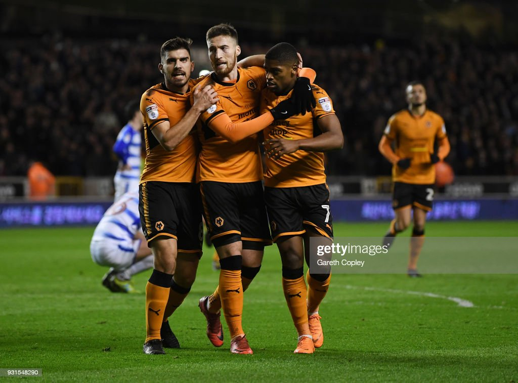 Matt Doherty (c) of Wolverhampton Wanders is congratulated on scoring the opening goal by Ruben Neves and Ivan Cavaleiro during the Sky Bet Championship match between Wolverhampton Wanderers and Reading at Molineux on March 13, 2018 in Wolverhampton, England.