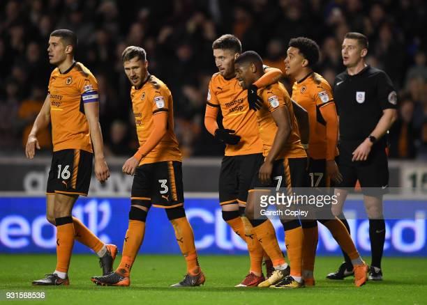 Matt Doherty of Wolverhampton Wanders is congratulated on scoring the third goal during the Sky Bet Championship match between Wolverhampton...