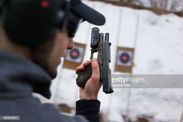 Matt Dolce holds his pistol at a class taught by King 33 Training at a shooting range on February 24 2013 in Wallingford Connecticut King 33 Training...