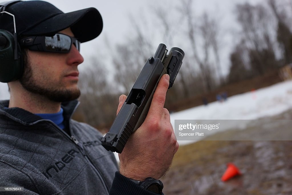 Matt Dolce holds his pistol at a class taught by King 33 Training at a shooting range on February 24, 2013 in Wallingford, Connecticut. King 33 Training, a company that trains and educates individuals on the safe and proper use of guns and other uses of protective force, offers classes to marksmen of all levels. The Connecticut company offers training for clients interested in maintaining a safe environment for themselves, their families, and those around them. Connecticut, home to a number of gun manufactures including Colt Defense, is a state with conflicting views on guns and gun ownership. Currently the state has some of the strictest gun control laws in the nation and its current governor Daniel Malloy is pushing for tougher measures following the shootings at the Sandy Hook School.