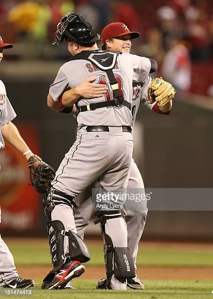 Matt Dominguez of the Houston Astros is hugged by Chris Snyder after the Astros 53 win over the Cincinnati Reds at Great American Ball Park on...