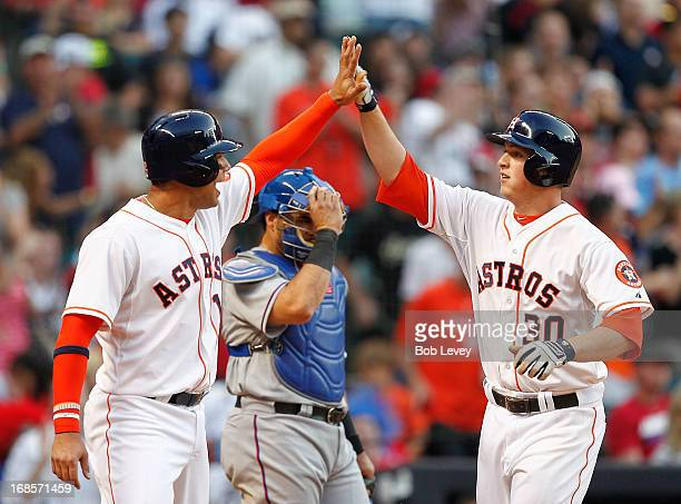Matt Dominguez of the Houston Astros receives congratulations from Carlos Pena after hitting a home run in the fifth inning against the Texas...