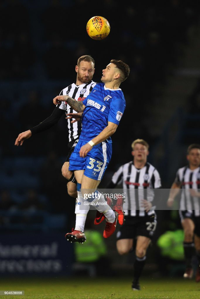 Matt Done of Rochdale (L) and Mark Byrne of Gillingham (R) jump for the ball during the Sky Bet League One match between Gillingham and Rochdale at Priestfield Stadium on January 13, 2018 in Gillingham, England. (Photo by Sarah Ansell/Getty Images).