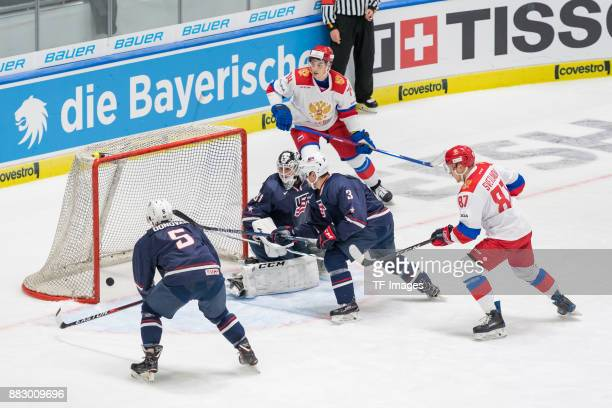 Matt Donovan of USA Brandon Maxwell of USA and Dylan Reese of USA in action and Nikolai Prokhorkin of Russia and Andrei Svetlakov of Russia score a...