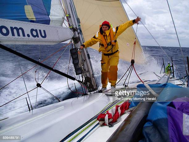Matt Drake walking back from the bow of the Volvo 60 Indec Merit crossing Bass Strait in the 2004 Rolex Sydney to Hobart Yacht Race on 27 December...