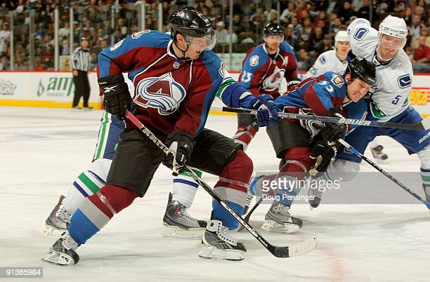 Matt Duchene and Adam Foote of the Colorado Avalanche skates against the Vancouver Canucks during NHL action at the Pepsi Center on October 3 2009 in...