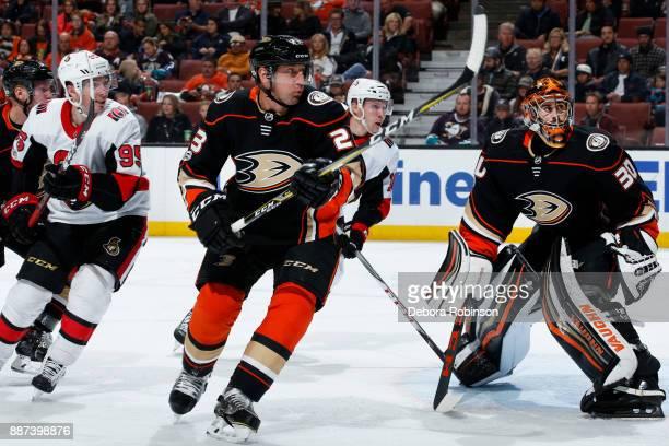 Matt Duchene and Ryan Dzingel of the Ottawa Senators battle in front of the net against Francois Beauchemin and Ryan Miller of the Anaheim Ducks...